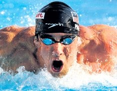 Brilliant Phelps shatters 200 butterfly mark