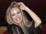 Boastful Berlusconi buys off party rebels