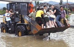 More than 80 dead as typhoons pound East Asia