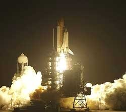Space shuttle Discovery blasts off