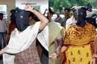 Arrested suspected Naxals raise slogans in favour of Maoists
