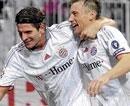 Bayern's chances revived; Milan held