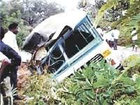 1 killed, 25 hurt as bus falls into drain