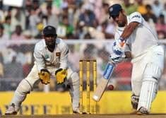 Dhoni hits century as India take firm grip
