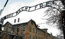 Auschwitz gate sign recovered, but damaged