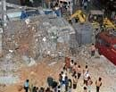 One dies in building collapse