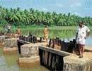 Unscientific bridge creates havoc for farmers in Siribagilu