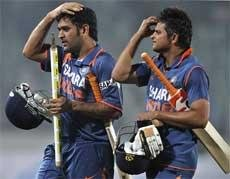 Dhoni, Kohli do the trick for India