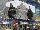 Obamas adorn billboards, reluctantly