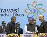 Return with wallets, vote, PM tells NRIs