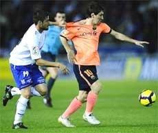 Mesmerising Messi hat-trick sends Barca top