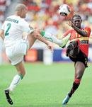 Angola pull Algeria to last eight