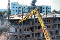 Collapsed building being demolished