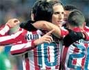 Forlan brace gives Atletico edge