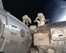 Astronauts take 2nd spacewalk to hook up plumbing