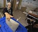 Iraqis vote as mortars and bombs rock Baghdad