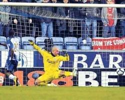 Rodallega strike helps Wigan stun Liverpool