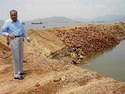 Government urged to check 'encroachment on sea'