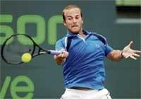 Rochus surprise for Djokovic; Henin wins