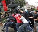 'Red shirts' defiant after clashes