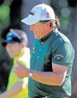 Westwood fends off Mickelson to keep lead
