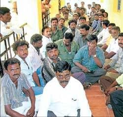KPTCL employees stage dharna alleging negligence by officers