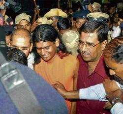 Godman goes into lock-up with laboured grin
