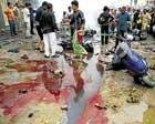 Bombs kill 64 in BaghdadBombs kill 64 in Baghdad