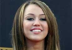 Miley excited about teaming up with Moore