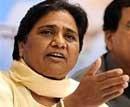 Oppn splits, Maya rescues UPA govt