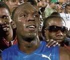 Bolt blazes track; Gay wins