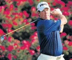 Cool Westwood stays in front