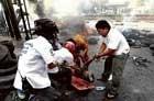 Deadly Bangkok clashes spread