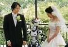Eyes flashing, robot conducts wedding in Tokyo