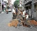 Palike asphalts road, water board digs it up to lay pipes