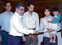 AI disburses compensation cheques for Rs one crore