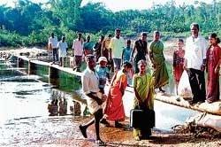 Villagers demand bridge
