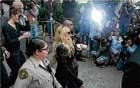 Celebrities, cameras and  theatrics strain courts