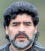 Maradona likely to stay as coach till 2014