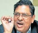 Hegde refuses to endorse CM's clean chit to Reddys