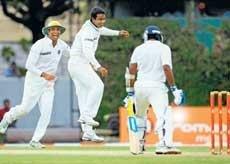 Lankans lay base for huge total
