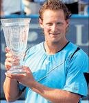 Nalbandian scores over Baghdatis to clinch title