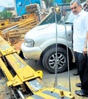 Mishap at Metro site: Heavy duty crane falls on moving car