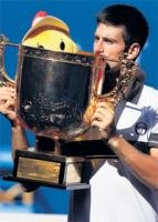 Djokovic, Wozniacki win China Open titles