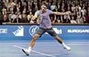 Federer breezes past Dent