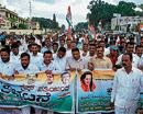 Congress activists hold protest rally in Hassan