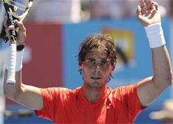 Ruthless Clijsters, Nadal advance