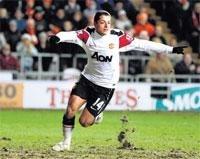 Man U rallies at Blackpool; Arsenal into cup final
