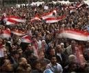 Egypt threatens crackdown but protesters stay put