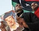 Britain freezes Gaddafi's assets